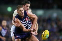 SUN-1401269 © WestPix AFL Round 3 - Fremantle Dockers vs Western Bulldogs, at Subiaco Oval, Perth. Pictured - Fremantle's Aaron Sandilands gets front position at the throw in against Tom Boyd Picture: Daniel Wilkins