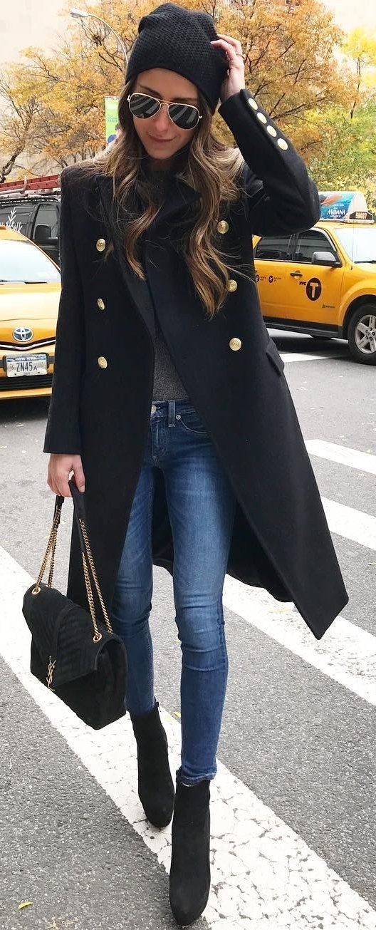 Black military coat, skinny blue jeans, YSL handbag