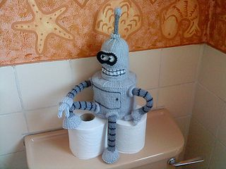 If you like Futurama, you'll love Bender! He's a handsome addition to the top of your cistern and he'll guard your spare roll.