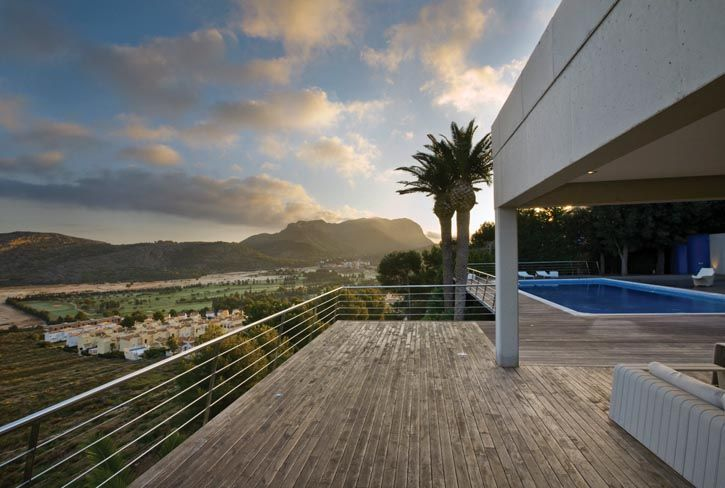 Denia, Spain, south of Barcelona  Take a siesta in cantilevered glass and concrete rooms that take full advantage of the views over a lush valley and exclusive golf community. This 5BR, 5 bath home lies very near the Mediterranean Sea. Its luminous, modern architecture calms the senses and excites the imagination.