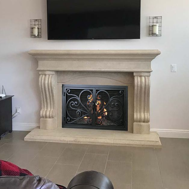Cast Stone Fireplace Mantels With Hand Forged Iron Fireplace Doors