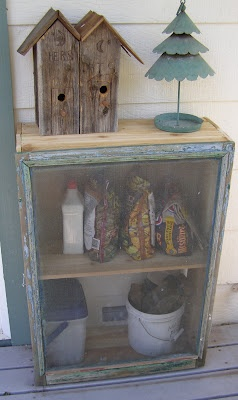 Vintage screen I got at a flea market for $3.00. Shabby chic, farm, gardening, deck. Hubby built cabinet with culled cedar boards for about $8.00, now it's an outdoor deck storage cabinet!