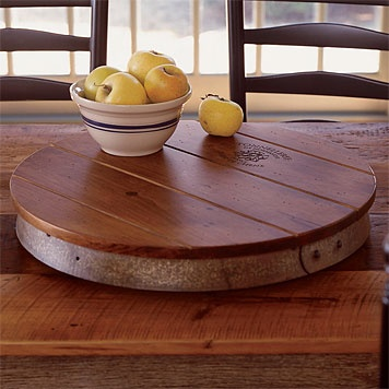 Wine Barrel Lazy Susan. Not that we have a lot of wine barrels laying around. But hey - it's a great idea.