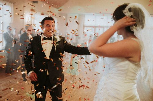 wedding photography, first dance with the bride and the groom under a confetti shower