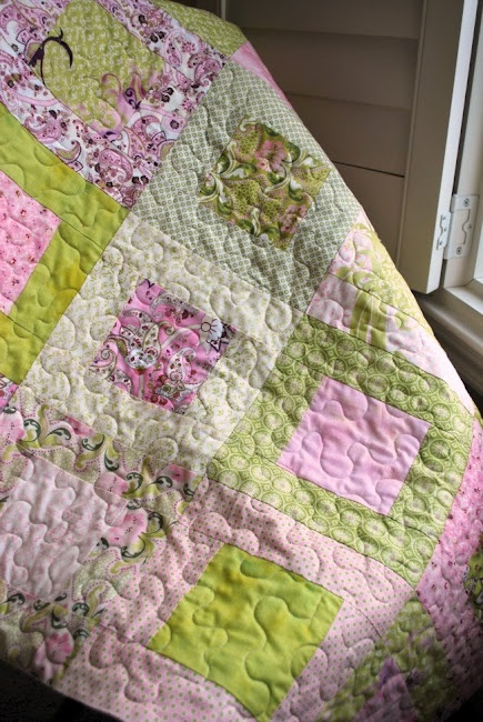 """Addie's Room - Purple and Green Baby Quilt. I agree with the creator, """"I love how these fabrics are part sweet shabby chic and part wild rocker girl."""" #shabbychic #rockergirl #babyquilt"""