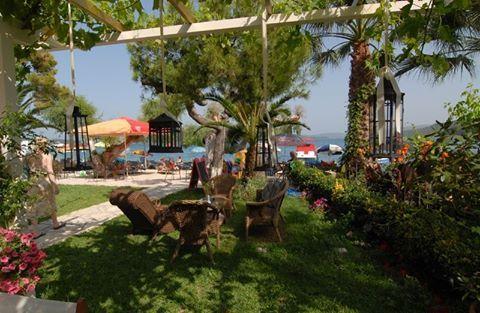At the beautiful yard of Eva Beach Hotel