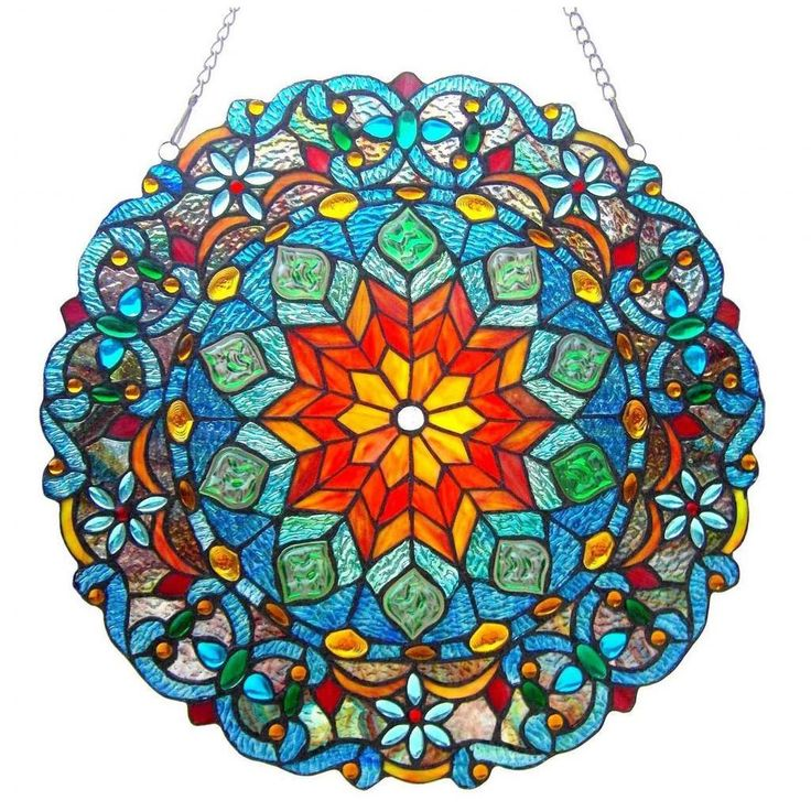 This Tiffany-style flower design window panel contains over 400 hand-cut pieces of colorful art glass and 136 jewels called Cabochons that will add color and warmth to any setting.