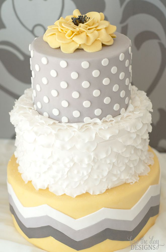 pale yellow (shall i say butter?) gray and white wedding cake with polka dots, flowers, chevron, and petals - sooo on trend right now (Fall 2011)