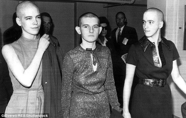 Van Houten (pictured left along with fellow Charles Manson cult members Atkins, right and Krenwinkel, center) arrives in court to hear the formal pronouncement of her death sentence