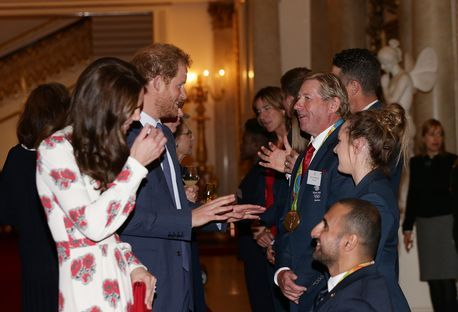 The Duchess of Cambridge and Prince Harry speak to athletes including Equestrian Nick Skelton (third left) during a reception for Team GB and ParalympicsGB medallists from the 2016 Olympic and Paralympic Games at Buckingham Palace