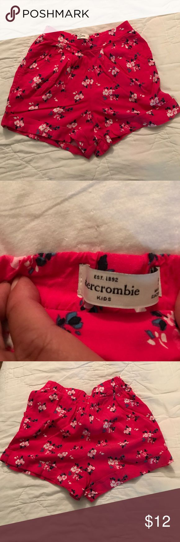 Light weight Abercrombie girls shorts Dark pink with flowers accents. Flowers are white, pink, & navy. Super lightweight. Like new. abercrombie kids Bottoms Shorts