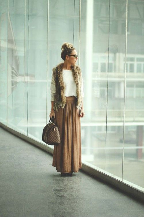 Maxi skirt and fur vest.