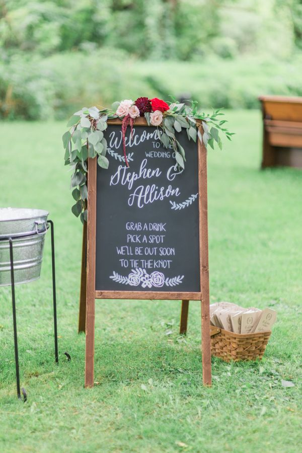 Rustic chalkboard wedding sign: http://www.stylemepretty.com/new-york-weddings/syracuse/skaneateles-syracuse/2015/09/14/rustic-glam-finger-lakes-wedding/ | Photography: Elizabeth LaDuca - http://elizabethladuca.com/