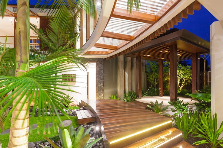 Chris Clout design Modern tropical resort house in Noosawaters with glass bridge landscaping lighting and man made creeks running through the home