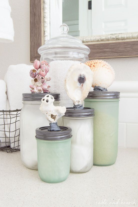 Beachy AND functional! Make this sea glass mason jar storage with just some simple spraypaint and shells from your collection!…