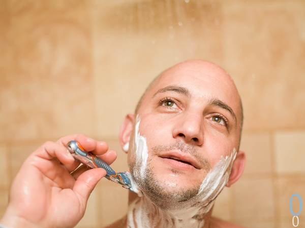 Shaving in The shower, getting ready for the wedding.  Playa Del Camrmen Mexico