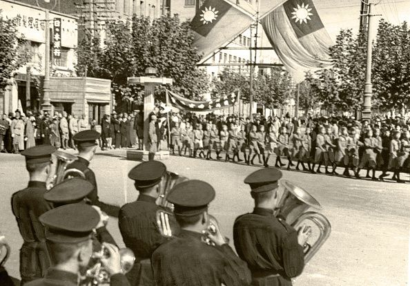 People march on during the National day celebration at the Nanjing Nationalist Government puppet state of Imperial Japan on October 10 1943 in...