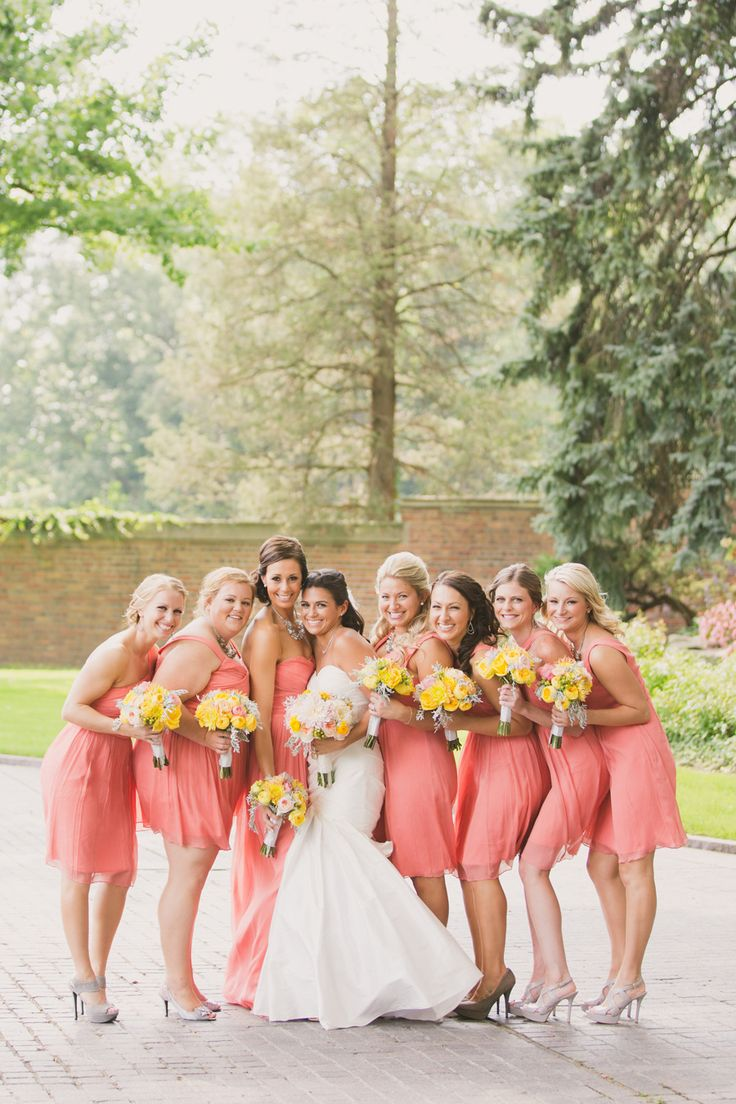 Coral bridesmaids | Event Planning: Hey Gorgeous Events - heygorgeousevents.com | Photography: Abby Rose Photo - abbyrosephoto.com  Read More: http://www.stylemepretty.com/2014/05/16/heart-themed-summer-wedding/