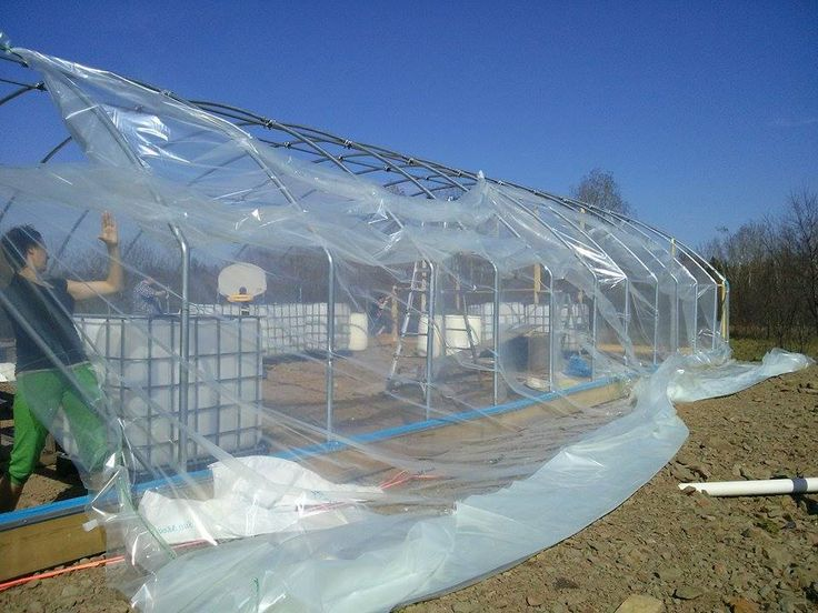 Pulling Over The Greenhouse Plastic Covering
