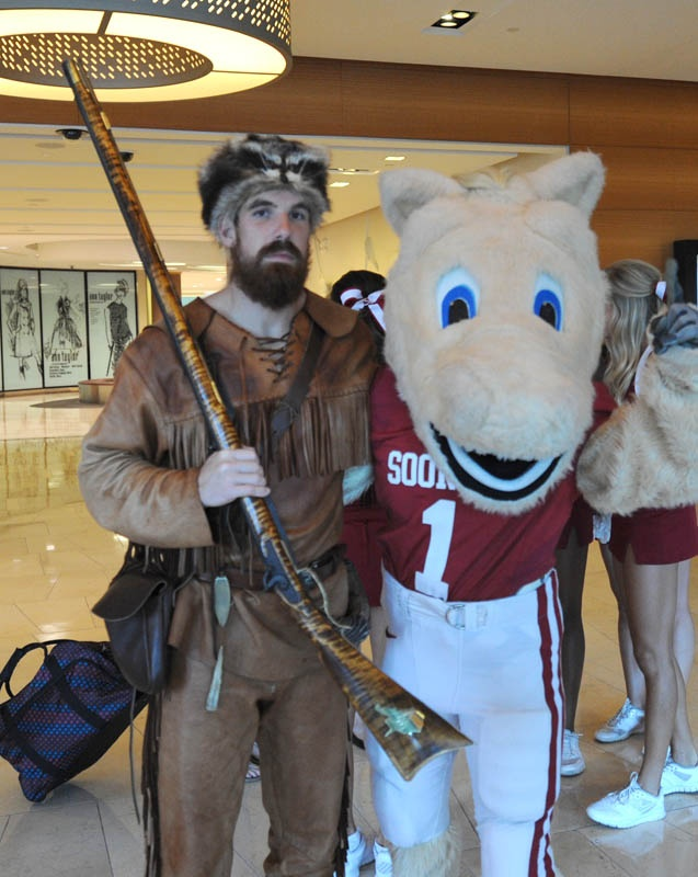 Mountaineer mascot with Boomer at the 2012 Big 12 football media days.