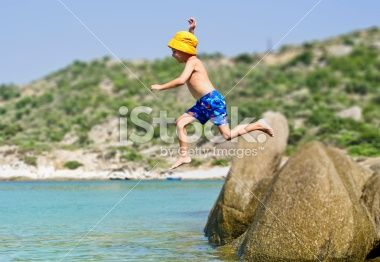 Boy jumping to the sea Royalty Free Stock Photo