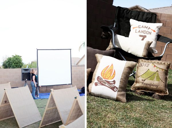 outdoor backyard camping party - movie screen, tents, and comfy customized pillows.