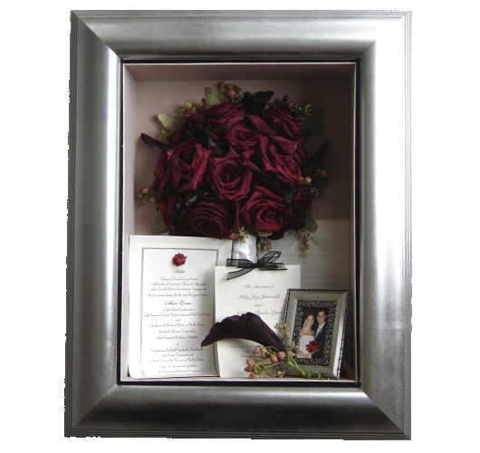 Contemporary Shadowbox by TimelessMoments.  This bride included other momentos from her wedding day.  Freeze Dried flowers look stunning in a framed display.  What would you do with your bouquet?  Contact www.TimelessMoments.com today for the best in professional freeze-dry preservation.