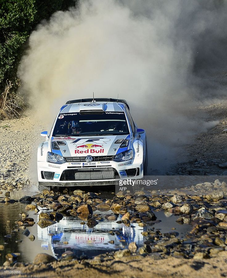 France's driver Sebastian Ogier and and co-driver Julien Ingrassia steer their Wolkswagen Polo WRC during the seventh stage of today's special stages of the FIA World Rally Championship of Italy near Monte Lerno around 20 kilometres southwest of Olbia on the Italian island of Sardinia, on June 21, 2013. AFP PHOTO / ANDREAS SOLARO