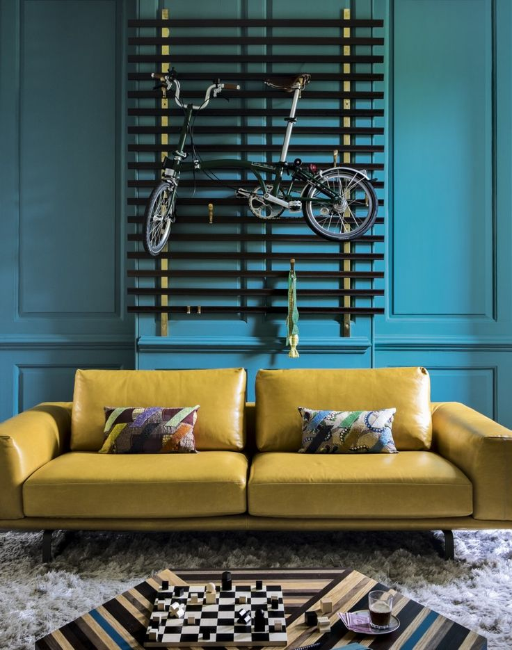 Modern teal living room with mustard leather sofa