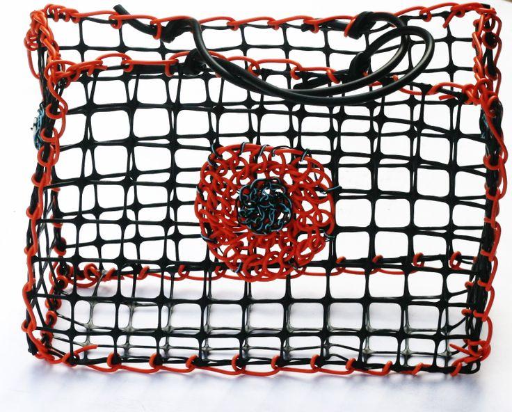 © Maritza Noa-Cabrera. Vintage inspired orange and black handbag. Plastic and telephone wire. Sold.