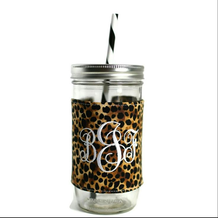 Loving the cheetah print tumbler with a white monogram!! Such a classic look!! All tumblers include a 24 oz glass jar, lid, BPA-free reusable straw and monogrammed fabric sleeve!! #preppy #monogram #personalizedtumbler