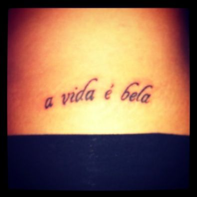 """My hip tattoo. """"Life is beautiful"""" (in Portuguese.)"""