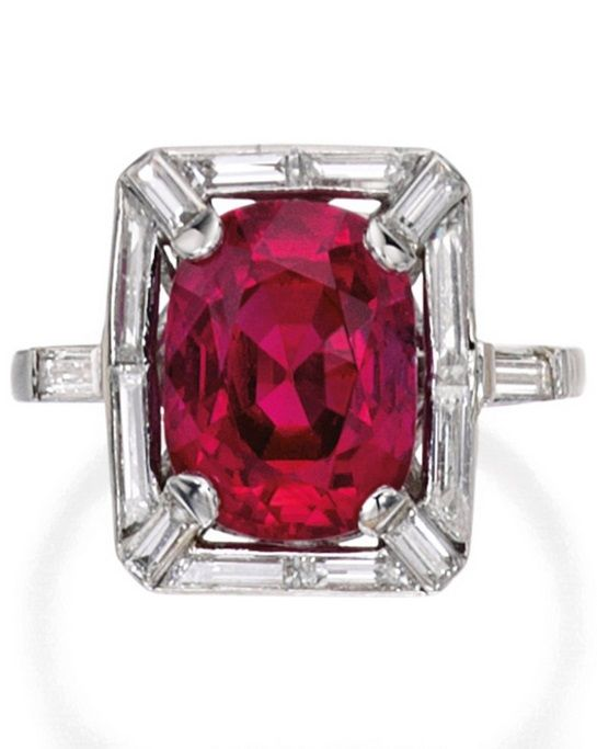 An Art Deco Platinum, Ruby and Diamond Ring, France, Circa 1930. Centring a cushion-cut ruby weighing 5.25 carats, framed by baguette and whistle-cut diamonds weighing approximately .80 carat, with French assay mark. #ArtDeco #ring