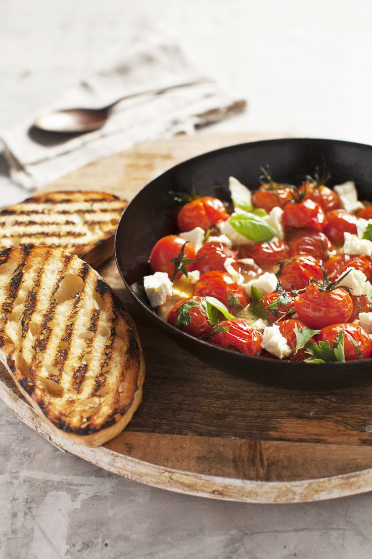Tomato Stew with Fetta on Toast. Make tomatoes on toast something really special. Soften cherry tomatoes with herbs, olive oil and garlic, then crumble Lemnos Fetta into the pan in the last couple of minutes of cooking, and serve on thick sourdough toast. #Lemnos #Fetta #recipe #tomato #yummy