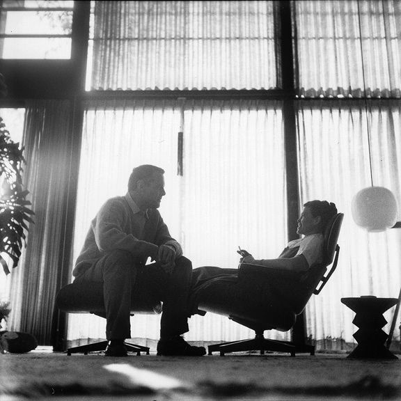 ray and charles eames sitting on the loung chair and ottoman