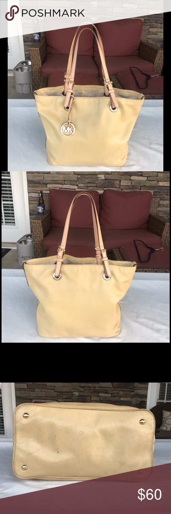 Michael Kors Tote / Purse I love the pale yellow color of this bag!  I'd say this bag is in fair to good condition. There is some weathered look on the sides, on the bottom and on the handles - see photos. But it is still a great looking designer bag! Make me an offer! 😊 Michael Kors Bags