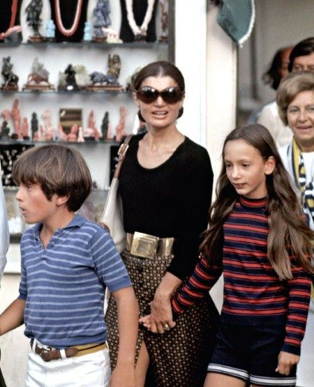 """Jackie with her niece and nephew, Anthony and Tina Radziwill in Capri, 1970. Photo by Ron Galella. """"I had been following her all day, and she said to the agents, """"Arrest this man."""" She'd left Ari's ship that morning and gone to one shop after another with her sister, Lee and Lee's children. Ari came up to me at one point and said, 'What are you doing here?' It amazed him that paparazzi could travel. That's when they called the police. They didn't go after me that time'"""