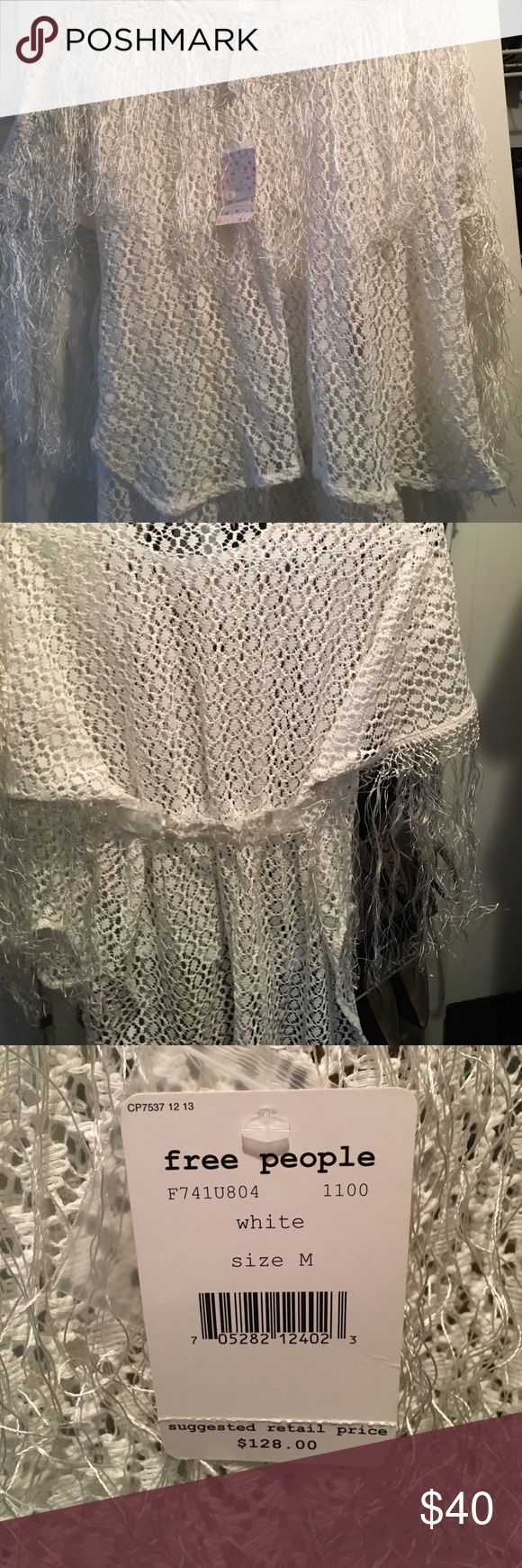 Free People short sleeve dress shirt Brand new with tags! Fun for a country concert with all of the frayed string! New Romantics with lace button detail in the back. So fun for summer. Priced super fair! Let's bundle! Free People Tops Tees - Short Sleeve