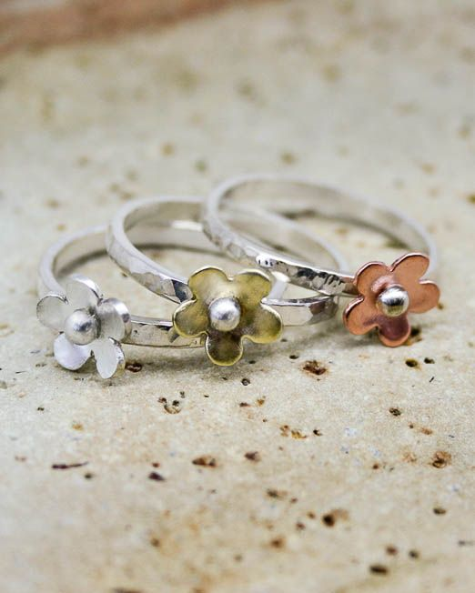 Flower stacking rings. The list price is for one ring, please specify which metal combination you would like at checkout.  Sweet and simple, this lovely ring is a must for everybody's jewellery collection  Available in silver, copper and brass and can be worn singularly or in groups.  The daisies have been hand saw pierced from copper, silver and brass then lightly domed and completed...