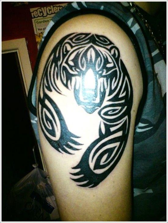 Black ink tribal bear tattoo on half sleeve