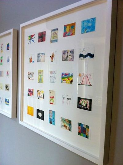 Super cute way to display your kids artwork! I'll have to remember this for the future...distant future! ;)