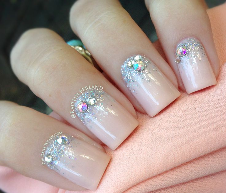 The Daily Polish using French Pink Nail Lacquer on the entire nail and Dazzle Me Up Stardust Nail Polish near the cuticle.  Diamond Crystal Rhinestones and the Rainbow Crystal Rhinestones. Topped off with Z Coat