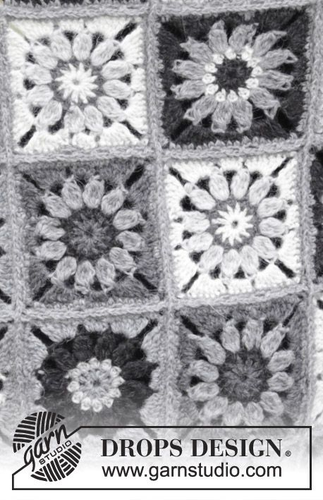 Blanket with crochet squares.  Piece is crocheted in DROPS Puna.