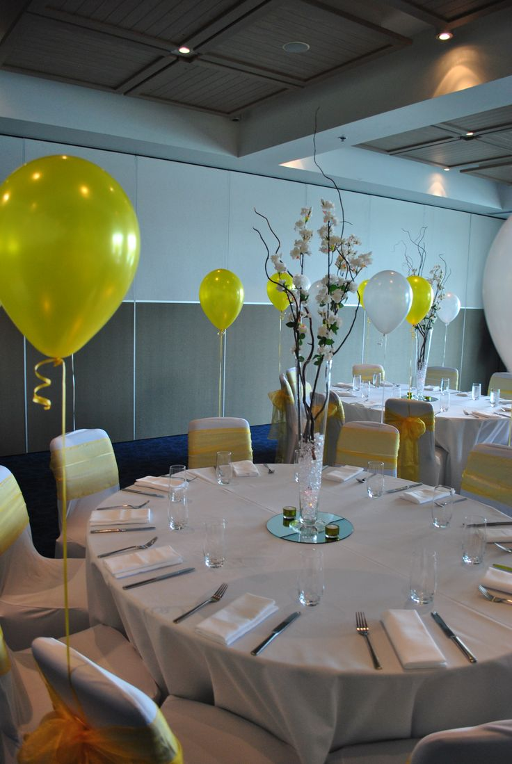Add height to your tables by using tall flowers as a centre piece. Put some balloons behind chairs to add a pop of colour to your venue. #flowers #centrepiece #event #party