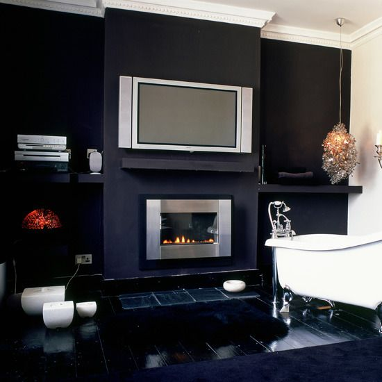 Wall Mounted Fireplace with tv sitting above on shelf
