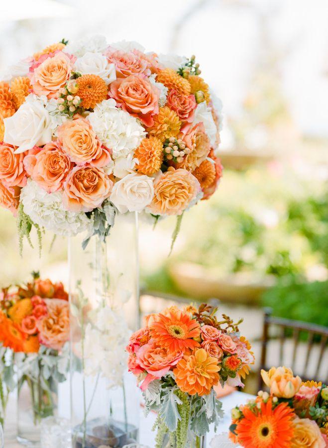 Orange wedding flower arrangement: http://www.stylemepretty.com/2014/11/08/bright-orange-malibu-wedding/ | Photography: Erin Hearts Court - erinheartscourt.com