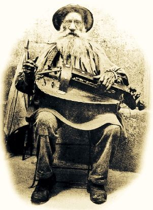 Old Hurdy Gurdy Player comes singing songs of love.