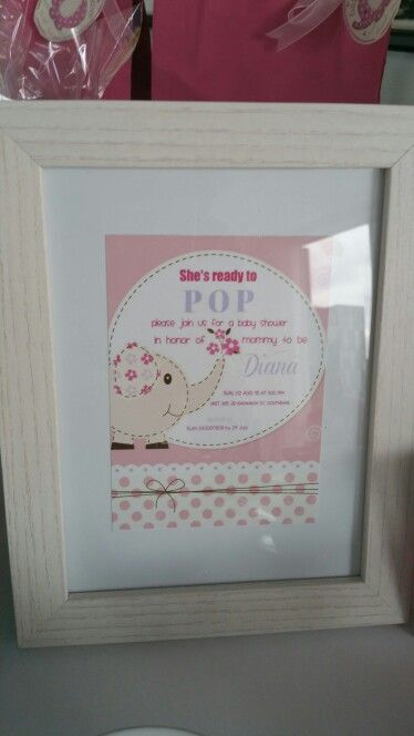 Invitation in a frame as a table decor