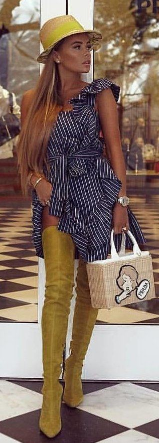 #spring #outfits woman wearing white and black striped cap-sleeved dress with yellow thigh-high boots and beige handbag. Pic by @glamor_world_of_street