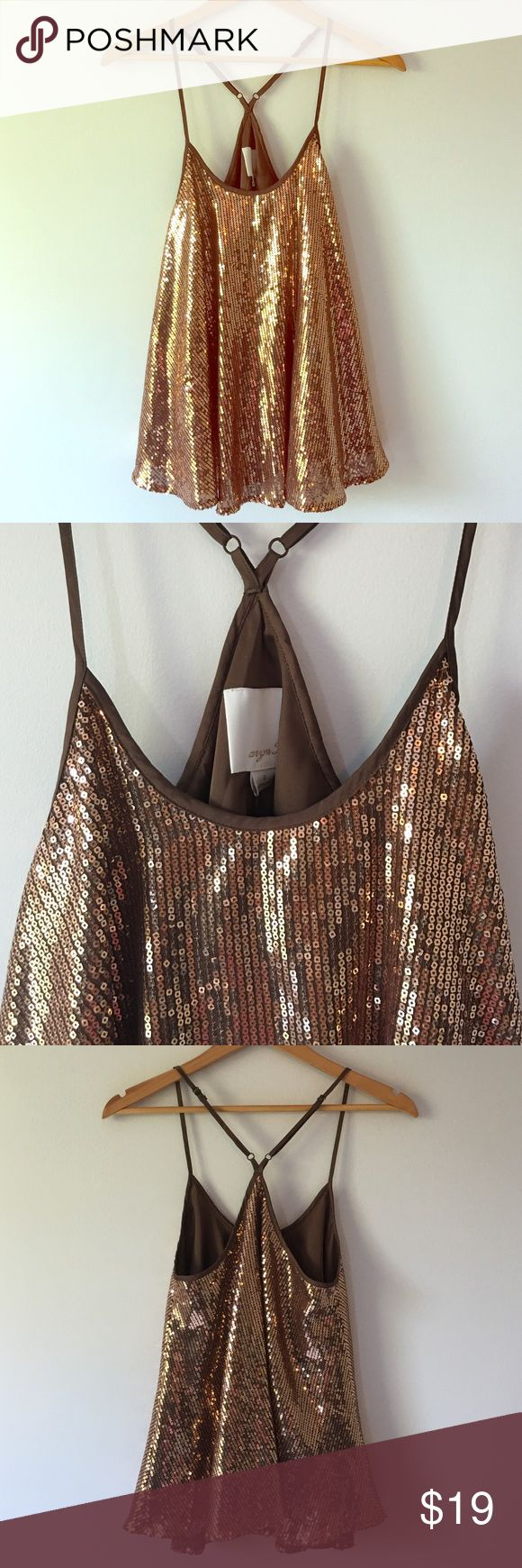 """{Anthropologie Aryn K.} Copper Sequin Swing Tank Anthropologie. Sassy, flowy copper sequin racer back tank. Adjustable straps. Fully lined. Perfectly paired with denim or pencil skirt. 17 1/2"""" pit to pit. 17 1/2"""" long from neckline to bottom of hem. (Two sequins missing in front of top. See example in photo 4.  Reflected in price). Tags attached. Anthropologie Tops Tank Tops"""